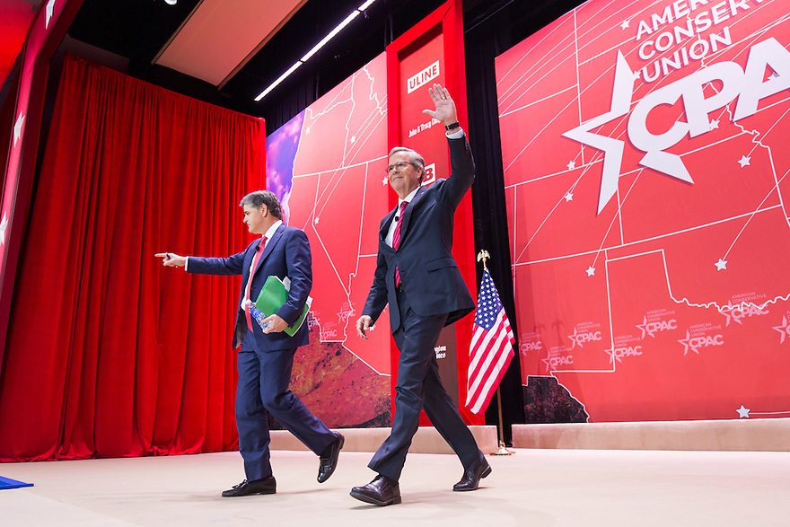 Former Florida Governor Jeb Bush arrives with Fox New's Sean Hannity  at the 2015 Conservative Political Action Conference (CPAC) outside Washington, DC