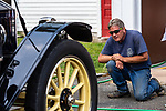 WOODBURY, CT. 16 July 2019-071619 - Woodbury Volunteer firefighter Captain Dave Lampart checks out a Stanley Steamer as it stopped by the Hotchkissville Firehouse in Woodbury on Tuesday. The Steamers need to stop every 35-50 miles to fill up with water as they operate by steam. A large group of owners of Stanley Steamers from around the country have gathered driving around the area touring the Litchfield Hills. Bill Shettle Republican-American
