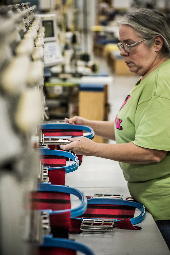 A step in the Stormy Kromer manufacturing process prepping the hat for automated embroidering of the logo at the Ironwood, Michigan production facility.