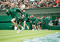 27-6-07,England, Wimbldon, Tennis, RAIN, Court attendants running on center court to put the cover on.