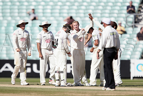 07.09.2012.  The Kia Oval Kennington London England.LV County Championship Division 1 Day 4 Surrey versus Nottinghamshire. Gareth Batty is congratulated by his team after he bowls Graeme White  during the LV County Championship match