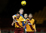 Motherwell v St Johnstone..30.12.15  SPFL  Fir Park, Motherwell<br /> Brian Easton gets above Marvin Johnson<br /> Picture by Graeme Hart.<br /> Copyright Perthshire Picture Agency<br /> Tel: 01738 623350  Mobile: 07990 594431
