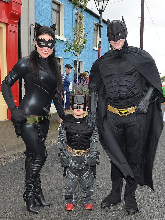 Reuben McGuiggan who met Catwoman and Batman at the Integral Clogherhead 10K. Photo:Colin Bell/pressphotos.ie