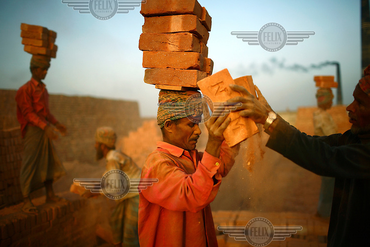 A labourer at a brick making factory in Fatullah near Dhaka. The workers come from the rural area of Gaibandha, and work at the brick factory until June, when the Monsoon stops work and they return to their homes. For each thousand bricks they move, they earn the equivalent of GBP 0.56.