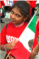 Cinco de Mayo parade participant age 11 with Mex. Flag.  St Paul Minnesota USA