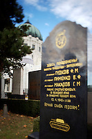 """Allerheiligen (All Saints) at Vienna's """"Zentralfriedhof"""" (""""Central Cemetary""""), the city's biggest graveyard. Karl Borroma?us Church, better known as Dr. Karl Lueger Memorial Church, by Max Hegele. Fallen Russian soldiers from WW2."""