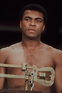 March 8, 1971 Madison Square Garden, NY. First fight between Muhammad Ali and Joe Frazier. Frazier won this first match. Ali on the weighing scale before the match.