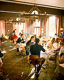USA, Utah, group of friends having breakfast at the Rustler Lodge, Alta Ski Resort