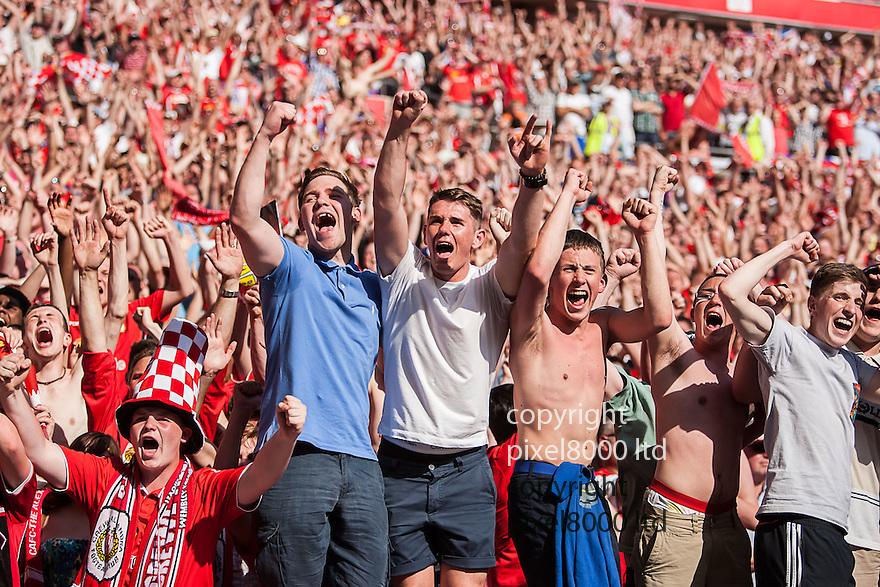 London, UK. Crewe fans celebrate after winning nPower League Two playoff final fixture Cheltenham Town versus Crewe Alexandra at Wembley Stadium 27 May.  Please Byline David Fearn Pixel 8000 Ltd
