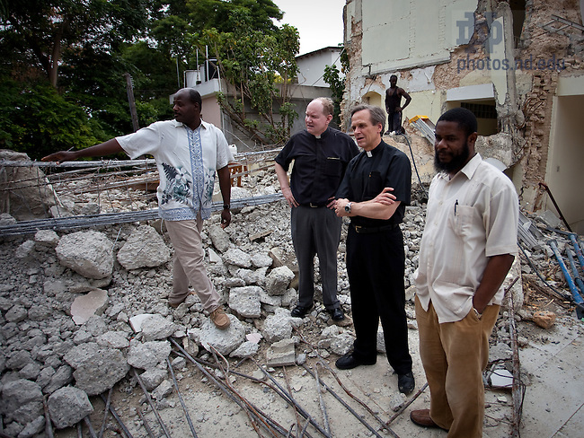 Rev. Tim Scully, C.S.C. and University President Rev. John Jenkins, C.S.C. view earthquake damage at the Congregation of Holy Cross provincial house in Port Au Prince Haiti, March 2010...Photo by Matt Cashore/University of Notre Dame