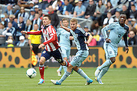 Chivas Jorge Villafana (19) midfield USA trying to get past Oriol Rosell (20) midfield Sporting KC..Sporting Kansas City defeated Chivas USA 4-0 at Sporting Park, Kansas City, Kansas.