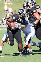 MU tailback Derrick Washington runs for eight yards before he is tackled by Western Michigan Broncos Justin Braska and Londen Fryar during the fourth quarter at Memorial Stadium in Columbia, Missouri on September 15, 2007. The Tigers won 52-24.
