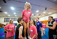 NWA Democrat-Gazette/JASON IVESTER<br /> Bentonville High junior Chasity Clark is lifted into a stunt by senior Riley Hurst and sophomore Meredith England Thursday, June 15, 2017, during the B2 Cheer &amp; Dance Northwest Arkansas Day Camp at Central Junior High School in Springdale. Cheer squads from local junior high and high schools are participating in the three-day camp hosted by Springdale Har-Ber High.