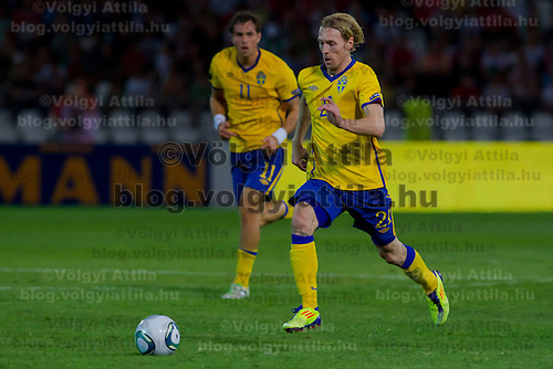 Sweden's Johan Elmander (L) and Christian Wilhelmsson (R) lead the ball during the UEFA EURO 2012 Group E qualifier Hungary playing against Sweden in Budapest, Hungary on September 02, 2011. ATTILA VOLGYI