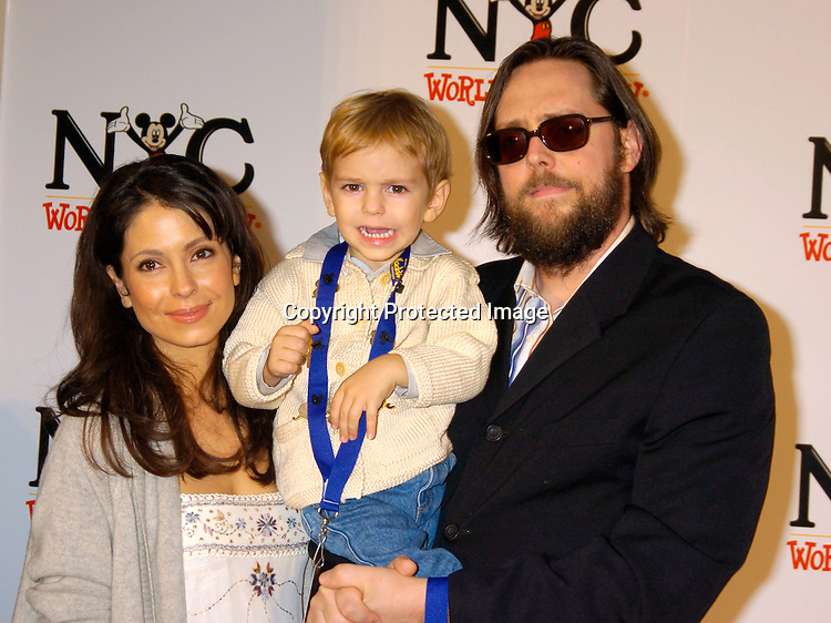 Lisa Locicero, Lukas and husband Michael Jann ..at the World of Disney Store opening on October 4, 2004 ..on Fifth Avenue in New York City. Photo by Robin Platzer, Twin Images