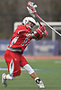 Steven Pinto #17 of Connetquot recoils for a shot during a Suffolk County varsity boys lacrosse game against host Huntington High School on Friday, April 7, 2017. He scored four goals, including three in the fourth quarter, to rally Connetquot from a 12-10 deficit in the final period to a 15-14 win.