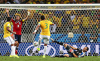 Thiago Silva of Brazil kicks the ball out of the hands of Colombia goalkeeper David Ospina resulting in a booking which means he misses the semi final vs Germany through suspension