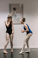 Ballerinas laughing during their lesson  at The Jason  Thomas School of Performing arts, Turo, Cornwall, UK 8th Februrary 2017.