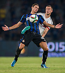 Samuele Longo of FC Internazionale Milano (L) competes for the ball with Alex Rodrigo Dias Da Costa of AC Milan (R) during the AC Milan vs FC Internacionale as part of the International Champions Cup 2015 at the looks onnggang Stadium on July 25, 2015 in Shenzhen, China.  Photo by Aitor Alcalde / Power Sport Images