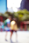 Blurred image of a couple walking through a city street