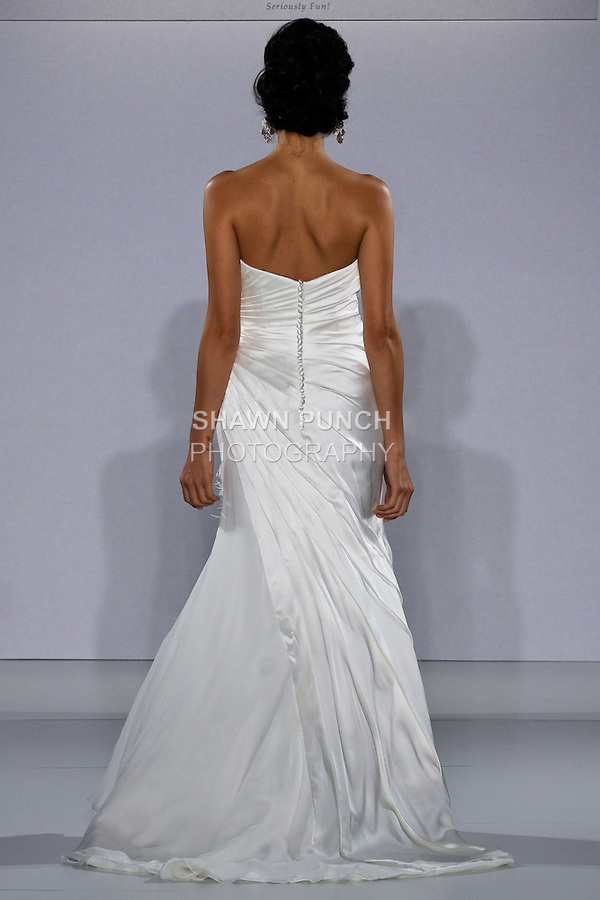 Model walks runway in an Enraptured wedding dress from the Matty by Matthew Christopher Spring 2013 collection, at the Couture Show, during New York Bridal Fashion Week Spring 2013.