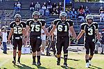 Palos Verdes, CA 10/30/09 - Peninsula Captains Mitch Seymour (#75), Anthony Papadakis (#22), Ryan Pierson (#3) and Robby Ahumada (#61) walk onto the field at the start of the game against Mira Costa.