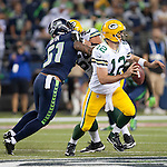 Green Bay Packers quarterback Aaron Rodgers (12) scrambles against the Seattle Seahawks in the NFL Kickoff held at CenturyLink Field September 4, 2014 in Seattle.Rodgers was sacked three times, once for a safety and passed for 189 yards for one touchdown and one interception. The Seahawks beat the Packers 36-16. ©2014  Jim Bryant Photo. ALL RIGHTS RESERVED.