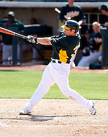 Eric Sogard #36 of the Oakland Athletics bats in an intrasquad game during spring training workouts at Phoenix Municipal Stadium on February 24, 2011  in Phoenix, Arizona. .Photo by:  Bill Mitchell/Four Seam Images.