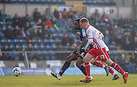 Anthony Stewart of Wycombe Wanderers plays a pass under pressure from Tom Conlon of Stevenage during the Sky Bet League 2 match between Wycombe Wanderers and Stevenage at Adams Park, High Wycombe, England on 12 March 2016. Photo by Andy Rowland/PRiME Media Images.