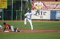 Deion Ulmer (3) of the Ogden Raptors leaps for the catch as a sliding Marten Gasparini (4) of the Idaho Falls Chukars heads to second base in Pioneer League action at Lindquist Field on June 23, 2015 in Ogden, Utah.  Idaho Falls beat the Raptors 9-6.(Stephen Smith/Four Seam Images)