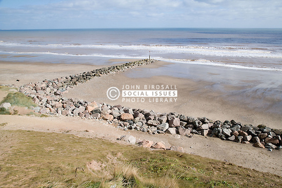 Rock groyne and beach riprap protecting beach and cliffs from erosion at Mappleton; East Yorkshire; England