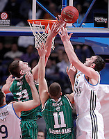 Real Madrid's Mirza Begic (r) and Union Olimpija Ljubljana's Alen Omic (l) and Dino Muric during Euroleague 2012/2013 match.December 13,2012. (ALTERPHOTOS/Acero) /NortePhoto