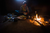 Rekha RAMESH's sister bakes indian bread in the kitchen of their house in Dhawati VIllage of Khaknar block of Burhanpur district in Madhya Pradesh, India.  Photo: Sanjit Das/Panos for ACF