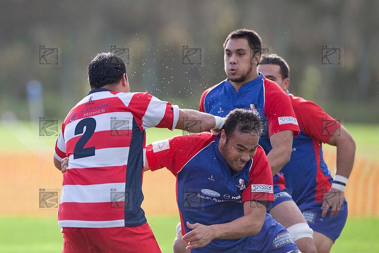 Sione Angaáelangi is taken in a tackle by Terence Otineru. Counties Manukau Premier Club Rugby game between Ardmore Marist and Karaka played at Bruce Pulman Park Papakura on Saturday June 11th 2011. Karaka won 42 - 25 after leading 21 - 18 at the break.