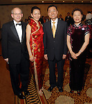 From left: David Leebron with his wife Y. Ping Sun with Xie Fung and Qiao Hong at the Asia Society Gala at the InterContinental Houston Hotel Thursday Feb. 26, 2009.(Dave Rossman/For the Chronicle)