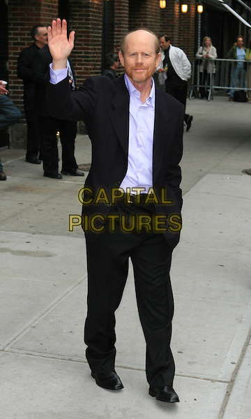"RON HOWARD (promoting ""Angels and Demons"").Appearance on the 'Late Show with David Letterman'.at the Ed Sullivan Theater, New York, NY, USA..May 14th, 2009.full length black suit purple shirt hand waving in pocket.CAP/LNC/TOM.©TOM/LNC/Capital Pictures."