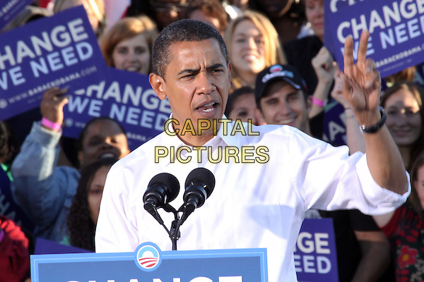 BARACK OBAMA.US Democratic Presidential  candidate  Sen. Barack Obama speaks at a rally held at Progress Plaza, Philadelphia, Pennsylvania, USA..October 11th, 2008.half length politics white shirt podium microphone speech hand white shirt .CAP/ADM/PZ.©Paul Zimmerman/AdMedia/Capital Pictures.