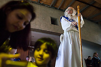 NWA Democrat-Gazette/CHARLIE KAIJO Father Time greets kids as Kaartika Pothuraju of Bentonville and Nethra Nirmal 4, take selfies during the Noon Year's Eve event on Sunday, December 31, 2017 at Crystal Bridges in Bentonville. Visitors rang in the New Year (without staying up past bedtime) at the third annual family celebration including arts projects, performances and a family dance party.