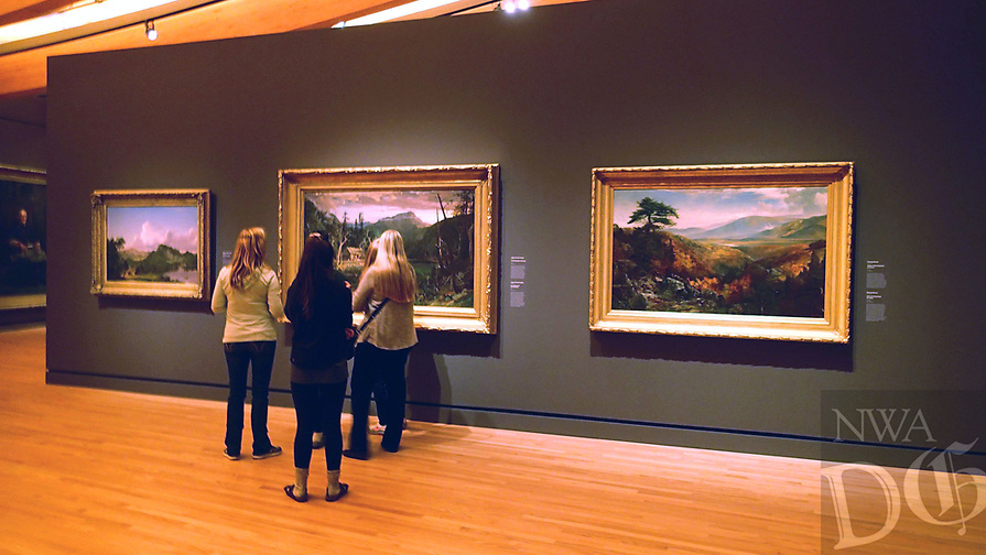 NWA Democrat-Gazette/FLIP PUTTHOFF <br /> Visitors look at paintings of nature Dec. 7 2018 at Crystal Bridges Museum of American Art.