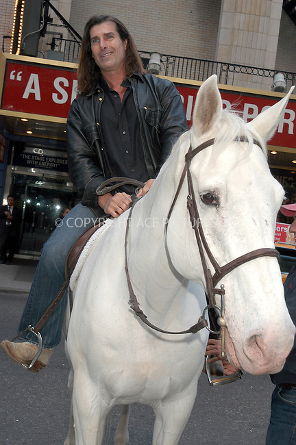 WWW.ACEPIXS.COM . . . . .  ....NEW YORK, APRIL 14, 2005....Fabio rides a horse in Times Square to promote the Oxygen Chanel's 'Mr. Romance.'....Please byline: KRISTIN CALLAHAN - ACE PICTURES.... *** ***..Ace Pictures, Inc:  ..Craig Ashby (212) 243-8787..e-mail: picturedesk@acepixs.com..web: http://www.acepixs.com