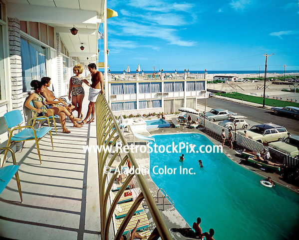 Hialeah Motel, Wildwood, NJ - 1966. Couples on the balcony overlooking the pool & playground 1966. This motel was demolished and condominiums are to be built in its place. It is now just a vacant lot.