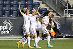 24 October 2014: Carli Lloyd (USA) (10) celebrates her first goal with Megan Rapinoe (USA) (15) and Ali Krieger (USA) (11). The United States Women's National Team played the Mexico Women's National Team at PPL Park in Chester, Pennsylvania in a 2014 CONCACAF Women's Championship semifinal game, which serves as a qualifying tournament for the 2015 FIFA Women's World Cup in Canada. The United States won the game 3-0. With the victory the U.S. advanced to the championship game and qualified for next year's Women's World Cup.