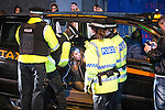© Joel Goodman - 07973 332324 . 01/01/2016 . Manchester , UK . Police remove people from a cab following a row about the fare . Revellers in Manchester on a New Year night out at the clubs around the city centre's Printworks venue . Photo credit : Joel Goodman