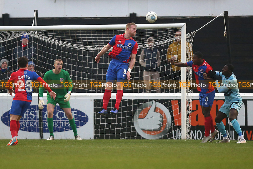 Kenny Clark of Dagenham heads clear during Dagenham & Redbridge vs Boreham Wood, Vanarama National League Football at the Chigwell Construction Stadium on 5th January 2019