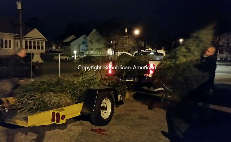 WATERBURY, CT - Dec. 9, 2015 - 120915AL02 - More than 10 Christmas trees were stolen from a fundraiser at Saints Peter and Paul Church in Waterbury the weekend after Thanksgiving. On Wednesday night, police found the stolen trees in a garage on Meriden Road and, with help from the Department of Public Works, returned them to the school.
