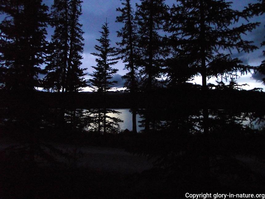 Dusk over serene Fish Lake, Alberta.