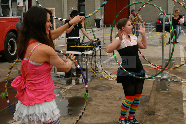 Lexington native Sonya Blaydes (left) hula hoops with Clinical Psychology Graduate Student Mary-Anne Edmundson (right), on Saturday,October 10 and the Boomslang Festival at Buster's.