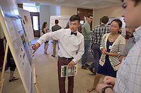 "Oscar Yip '17 talks about his research on ""Phenotypic Characterization of Suppressors of tba-1 Neural Defects."" After researching all summer, Occidental College students present their work at the annual Summer Undergraduate Research Conference on July 29, 2015.<br /> (Photo by Marc Campos, Occidental College Photographer)"