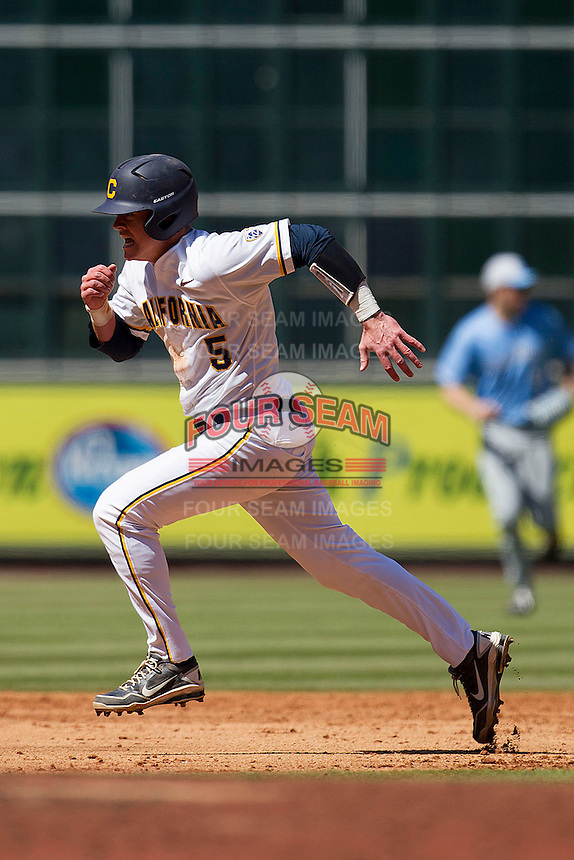 California Golden Bears catcher Andrew Knapp #5 hustles towards third base against the North Carolina Tar Heels in the NCAA baseball game on March 2nd, 2013 at Minute Maid Park in Houston, Texas. North Carolina defeated Cal 11-5. (Andrew Woolley/Four Seam Images).