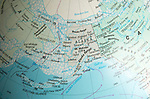 North America map on a globe focused on Alaska and Bering Sea